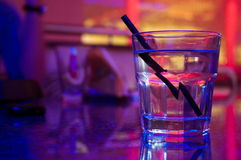 Glass of alcohol drink in the night club. On the table stock images