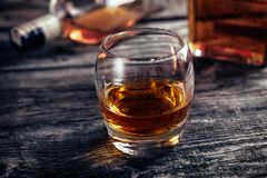 Glass with alcohol drink whiskey. On bar table Royalty Free Stock Photography