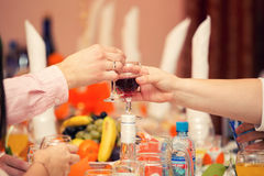 Glass  alcohol in hands of guests Royalty Free Stock Image