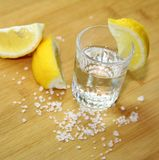 Glass of alcohol and lemon Stock Photography