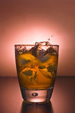 Glass of alcoholic drink Stock Image
