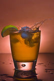 Glass of alcoholic drink Stock Photo