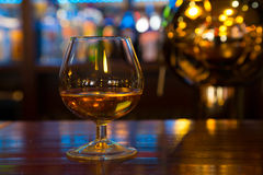 Glass with an alcoholic drink Stock Images