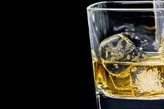Glass of alcoholic drink on black background Royalty Free Stock Photo