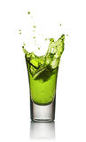 Glass of alcoholic drink with ice. Absinthe or mint liquor shot Royalty Free Stock Photos