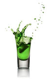 Glass of alcoholic drink with ice. Absinthe or mint liquor shot Stock Image
