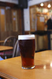 Glass of ale in pub Royalty Free Stock Photo