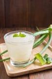 Glass of aloe vera juice on wooden background Stock Photo