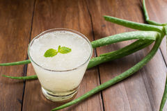 Glass of aloe vera juice on wooden background Royalty Free Stock Photography