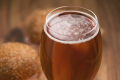 Glass of amber beer agains sanwiches with ham Stock Photography