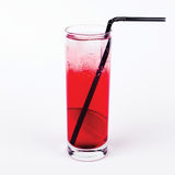 Glass of Americano cocktail with straw on white background. Deliciously Royalty Free Stock Photos