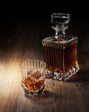 Glass And Bottle With Whiskey On A Woden Table Stock Photo
