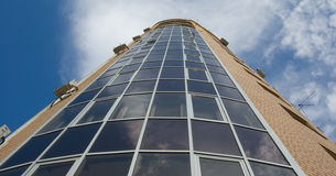 Glass And Yellow Brick Multistory Tower House Stock Photography