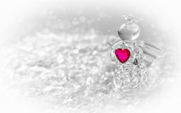 Glass angel. With a heart in the snow stock images