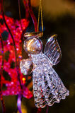 Glass angel as Christmas tree decoration. Glass angel bringing a heart as Christmas tree decoration stock photography