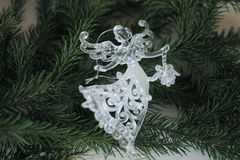 Glass angel decoration and Christmas tree branch. As background stock photography
