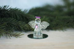 Glass angel decoration and Christmas tree branch. As background, place for text stock photo