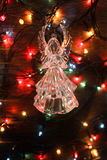 Glass angel with garland. Glass garland angel Christmas lights stock photography