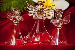 Glass Angel 5. Glass Angel on Red Velvet reflecting the yellow flower of the frangipani tree royalty free stock photos