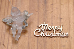 A glass angel. On a wooden background stock images