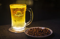 Glass of angkor beer draft with peanuts in cambodia Royalty Free Stock Photography