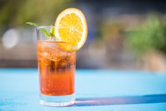 Glass of aperol spritz with mint and a orange slice on a sunny day. royalty free stock images