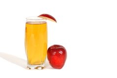 Glass of apple juice. A glass of apple juice with an apple wedge and apple next to glass Stock Photo