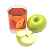 Glass with apple juice and apple. Transparent glass with apple juice and green apple and half apple Stock Photo