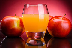 Glass of apple juice with apples Stock Image