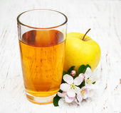 Glass of apple juice Stock Photos