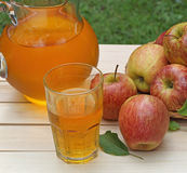 Glass of Apple Juice. With apples and a pitcher Stock Photo