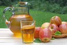Glass of Apple Juice. With apples and pitcher in background Stock Images