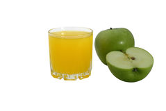 Glass of apple juice and apples on a white background. Glass of apple juice and green apples on the white, isolated background Royalty Free Stock Photography