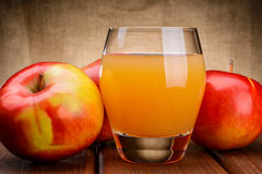 Glass of apple juice with apples Stock Images