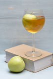 Glass of apple juice and book Stock Photography