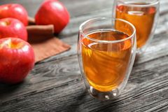 Glass of apple juice on dark   table. Glass of apple juice on dark wooden table Royalty Free Stock Image