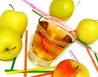 glass of apple juice and fresh apples on white Royalty Free Stock Photos