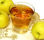 glass of apple juice and fresh apples on white Stock Images