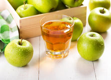 Glass of apple juice with fresh fruits Royalty Free Stock Image