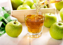 Glass of apple juice with fresh fruits Royalty Free Stock Photo