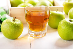 Glass of apple juice with fresh fruits Royalty Free Stock Images