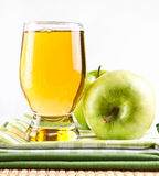Glass of apple juice and green apple Royalty Free Stock Image
