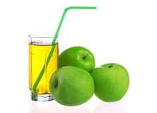 Glass of apple juice with green apples Stock Image