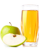 Glass of apple juice and green apples Royalty Free Stock Image