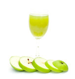 Glass of apple juice and green apples slice Stock Photo