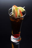 Glass of apple juice with ice Royalty Free Stock Images
