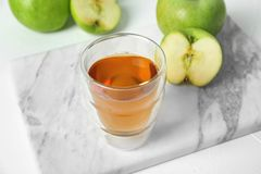 Glass of apple juice. On marble board Royalty Free Stock Photos