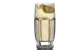Glass with apple juice, mineral water, ice and lime on the white Royalty Free Stock Photography