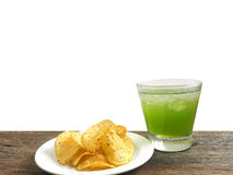 Glass of apple juice and potato chips. Isolated on white background Royalty Free Stock Photo