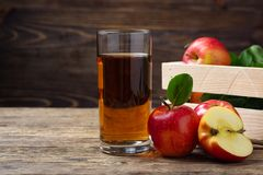 Glass of apple juice with red apples royalty free stock photos